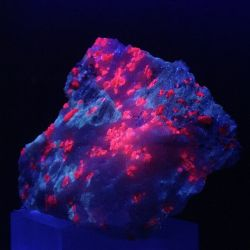 Spinel In Marble Glowing Under Ultra Violet Light